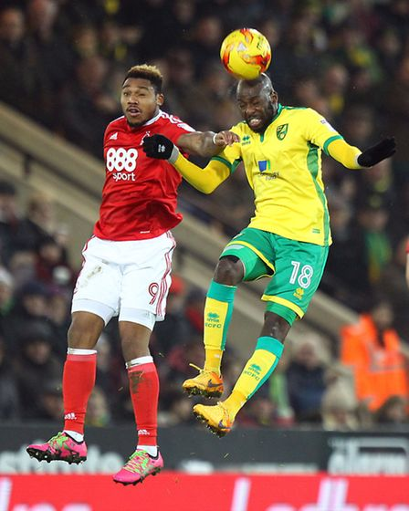 Youssouf Mulumbu of Norwich and Britt Assombalonga of Nottingham Forest in action during the Sky Bet