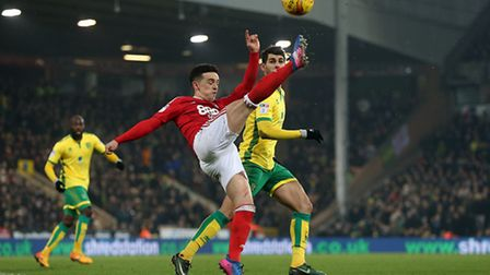 Zach Clough of Nottingham Forest and Nelson Oliveira of Norwich in action during the Sky Bet Champio