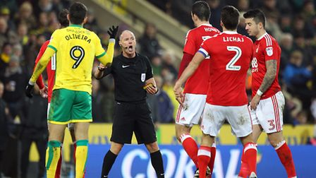 Referee Scott Duncan tries to calm things down as tempers flare during the Sky Bet Championship matc