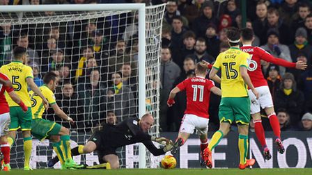 John Ruddy of Norwich saves at the feet of Ben Osborn of Nottingham Forest during the Sky Bet Champi