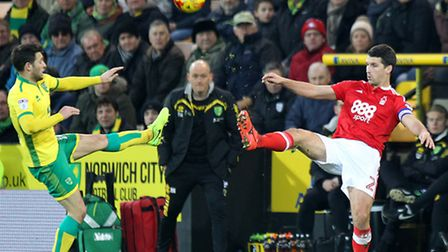 Norwich Manager Alex Neil watches on as Wes Hoolahan of Norwich and Eric Lichaj of Nottingham Forest