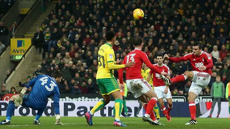 Jack Hobbs of Nottingham Forest clears the ball ahead of Josh Murphy of Norwich during the Sky Bet C