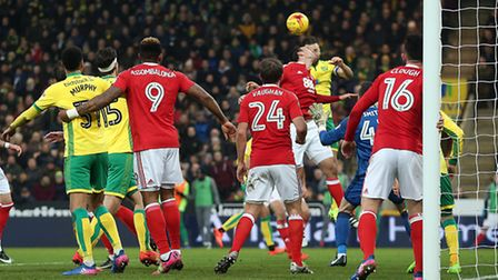 Russell Martin of Norwich sees his header cleared off the line by Zach Clough of Nottingham Forest d
