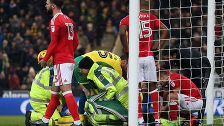 Players are concerned as Stephen Henderson of Nottingham Forest lays injured after Norwich's 3rd goa