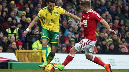 Ivo Pinto of Norwich and Jamie Ward of Nottingham Forest in action during the Sky Bet Championship m