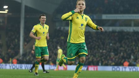 Alex Pritchard celebrates scoring his second and Norwich City's fifth against Nottingham Forest at C