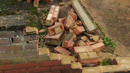 Damage to a garden wall after a road accident in Cowper Road, Dereham. Picture: TERRY BURRELL
