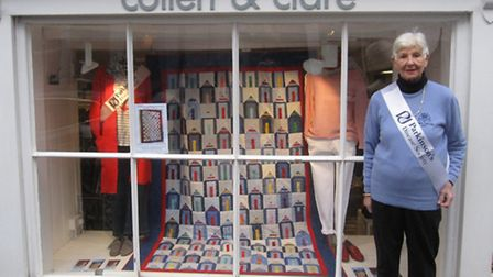 Jackie Selby, Ladies Captain of Southwold Golf Club, proudly showing off the Quilt in Collen & Clare