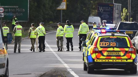Police search for Corrie McKeague last year in Barton Mills on the A11. Picture: Gregg Brown