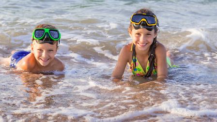 Two youngsters enjoy the sun. Picture: 3sbworld/Getty Images/iStockphoto