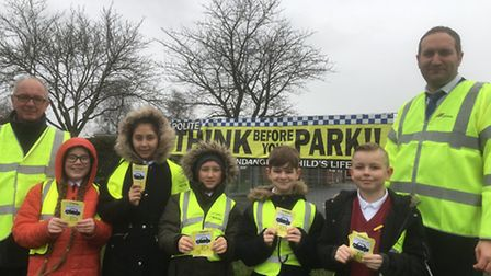 Members of Hillside Primary School's council on parking patrol with chairman of the governors Trevor