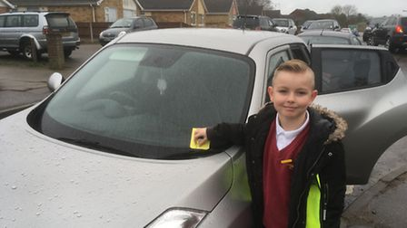 Hillside Primary School pupil Jacob tickets a car. Picture: David Hannant