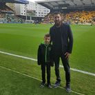 Alfie Oswick with dad Dan at Carrow Road. Alfie was the community hero who carried out the match ba