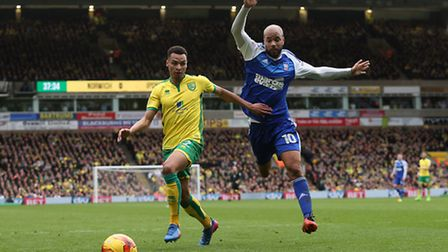 Jacob Murphy fends off Ipswich Town striker David McGoldrick, who takes to the air. Picture: Paul Ch