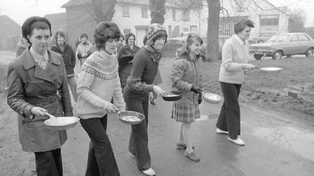Things look competitive at the Ashill pancake race in 1975. Photo from Archant Library.
