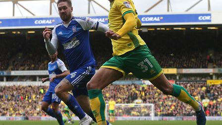 Josh Murphy of Norwich and Luke Chambers of Ipswich Town in action at Carrow Road, Norwich ( Picture