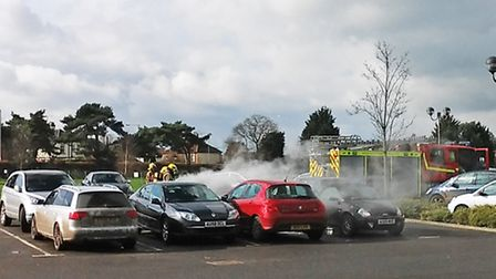 The car on fire at Victory Swim and Fitness Centre in North Walsham. Picture: TIM DYE