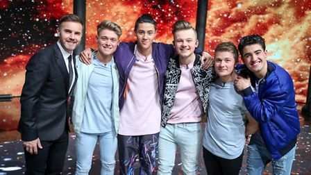 Gary Barlow (left) with the band members of Five To Five , the winners of the BBC One talent search