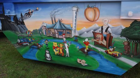 Great Yarmouth skip company WT Skip Hire has created a landscape on the side of a skip with characte