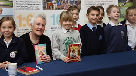 Author Vivian French poses with children from the six schools that attended the Book Week presentati