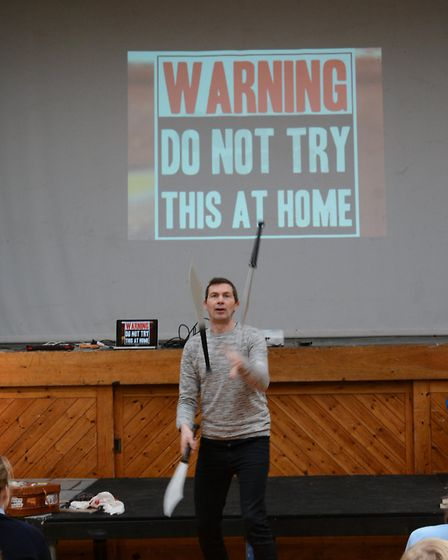 Author Julian Segwick treats school children to a knife throwing display. Picture: Beeston Hall Scho