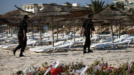 Police officers patrolling the beach near the RIU Imperial Marhaba hotel in Sousse, Tunisia, where 3
