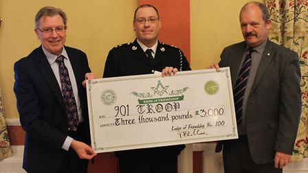 This picture shows the Provincial Grand Master, Stephen Allen (left) presenting the donation to Keit