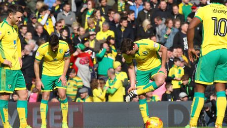 The Norwich players look dejected after conceding their sides 1st goal during the Sky Bet Champions