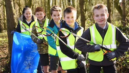 Rackheath Primary School children pick up litter in their local woods for the launch of the Great Br