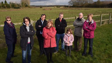 Claire Gunn, 2nd left, and other local residents angry at a 259 home development in the field behind
