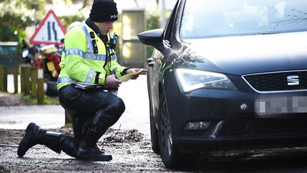 Norfolk Police stopping drivers using mobile phones along Unthank Road.Picture: ANTONY KELLY