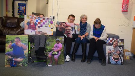 Anne Lown with some of the pictures of About with Friends members funded through her Facebook comept