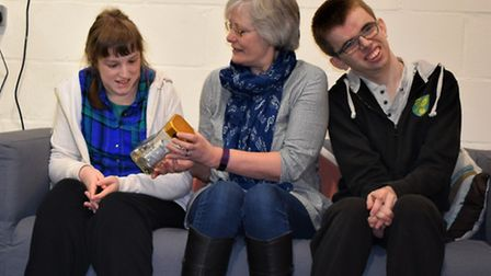 Anne Lown presenting a cheque for £603 to About with Friends members from a competition to spot my