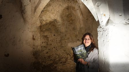 Author Elly Griffiths pictured with her new book The Chalk Pit in the undercroft below Guildhall.Pi