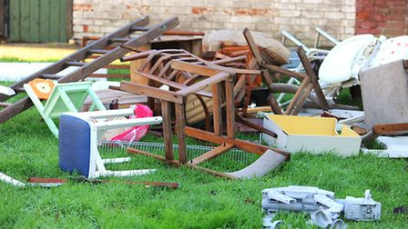 Rubbish fly-tipped behind houses off Lawn Avenue in Great Yarmouth. Picture: James Bass