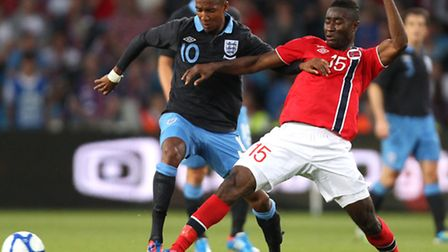 Norwich City midfielder Alex Tettey, right, tackles England's Ashley Young during a Norway game in 2