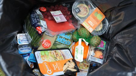 Food thrown away in a dustbin. Consumers are throwing away �13 billion of edible food from homes a y
