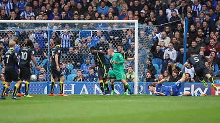 Morgan Fox of Sheffield Wednesday scores his sides 3rd goal during the Sky Bet Championship match at