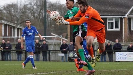 Lowestoft keeper Jake Jessup deals with the danger. Photo: Shirley D Whitlow.