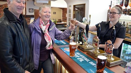 Watton residents John and Judy Kerr have the first drinks in the newly-opened Kings Arms in Watton.