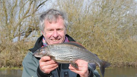 John Bailey and a 3lb 11oz graylin caught during a filming trip in Dorset recently. Picture: John Ba
