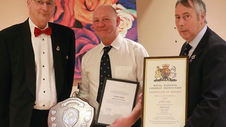 Cubitt Sieley receiving his record of service and volunteering award. Picture: HAPPISBURGH RNLI