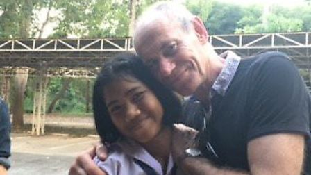 Cake and Paul Coleman in Thailand. Picture: Compassion UK