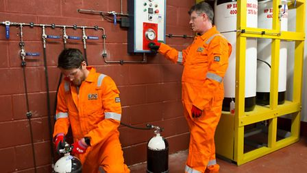 EPIC International staff Mark Payne and Tony Lewis testing cylinders in the company�s new testing ce