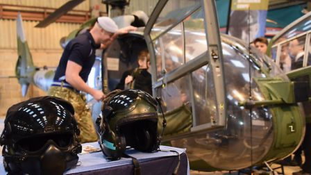 Long Stratton High School students are shown around a Gazelle helicopter by Cpl Paul Lockett of the