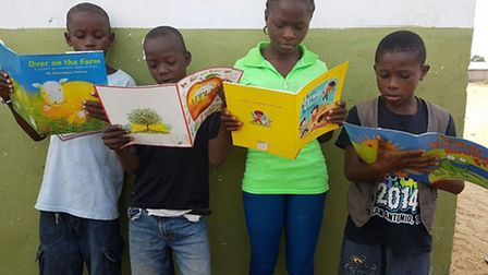 (From left) George, Thomas, Arianna and Gabriel, aged eight-12, at the VOA Academy near Monrovia enj