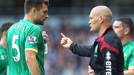 Russell Martin takes instruction from Alex Neil during last season's Premier League campaign. Pictur