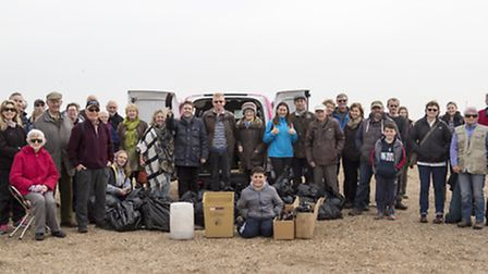 The beach clean volunteers at the finish of the Southwold event with their haul of rubbish. Pictures