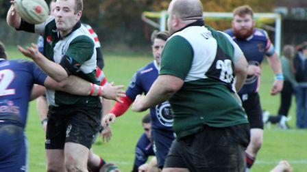 Norwich Union's man-of-the-match Jake Rodwell offloads to skipper Simon Pitcher during the 18-11 win