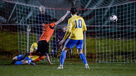 Action from the Norfolk Senior Cup Semi Final at the FDC in Norwich. Norwich Utd score a late equali
